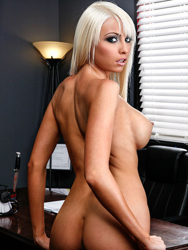 You Gotta Love Busty Rikki Six As She Is Posing In A Black Tank Top And Getting Ready To Shag.