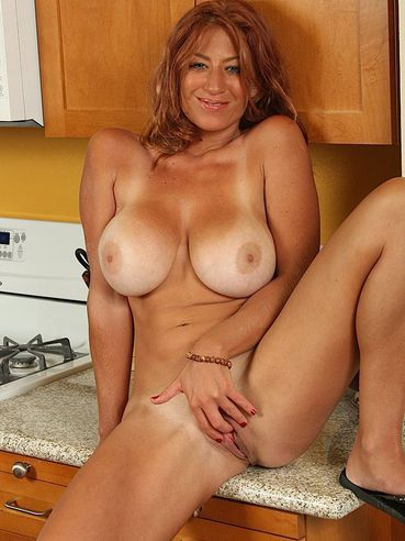 Big Titted Milf Lucky Benton With Tan Lines Gets Naked And Shows Her Twat In The Kitchen