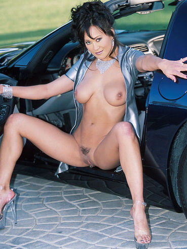 Busty Asia Carrera Unzips Her Latex Dress And Fingers Her Lovely Pussy Beside A Car