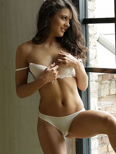 Sexy Ass Raven Babe Carolina Abril Poses By The Window In Her Lace White Underwear
